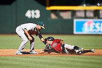 Oakland Athletics Josh Vidales (21) tags Gabriel Maciel (4) sliding into second base during an Instructional League game against the Arizona Diamondbacks on October 15, 2016 at Chase Field in Phoenix, Arizona.  (Mike Janes/Four Seam Images)