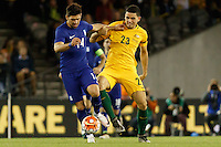 June 7, 2016: ANASTASIOS BAKASETAS (14) of Greece and TOMAS ROGIC (23) of Australia compete for the ball during an international friendly match between the Australian Socceroos and Greece at Etihad Stadium, Melbourne. Photo Sydney Low