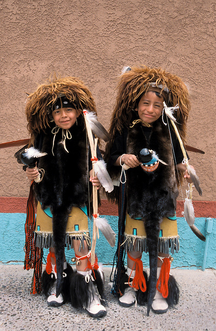 Santa Clara boys 7-9 years old dress up in traditional regalia with buffalo headdresses during feast days and celebrations to dance their ancestral buffalo dance