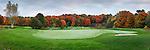 Golf course, beautiful panoramic fall nature scenery at dawn, putting green and sand trap. Muskoka, Ontario, Canada.
