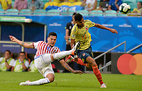SALVADOR – BRASIL, 23-06-2019: Luis Diaz de Colombia disputa el balón con Gustavo Gomez de Paraguay durante partido de la Copa América Brasil 2019, grupo B, entre Colombia y Paraguay jugado en el Arena Fonte Nova de Salvador, Brasil. /Luis Diaz of Colombia vies for the ball with Gustavo Gomez of Paraguay during the Copa America Brazil 2019 group B match between Colombia and Paraguay played at Fonte Nova Arena in Salvador, Brazil. Photos: VizzorImage / Julian Medina / Cont /