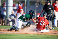 Dartmouth Big Green catcher Bennett McCaskill (18) tags Michael Geaslen (13) out while sliding into home during a game against the Northeastern Huskies on March 3, 2018 at North Charlotte Regional Park in Port Charlotte, Florida.  Northeastern defeated Dartmouth 10-8.  (Mike Janes/Four Seam Images)