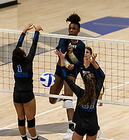 Trinity Luckett (5) drills the ball against Olivia Hall (1) at Rogers High School, Rogers, AR, on Thursday, September 9, 2021 / Special to NWADG David Beach