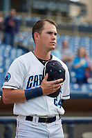 Lake County Captains center fielder Austen Wade (24) stands for the national anthem before the first game of a doubleheader against the South Bend Cubs on May 16, 2018 at Classic Park in Eastlake, Ohio.  South Bend defeated Lake County 6-4 in twelve innings.  (Mike Janes/Four Seam Images)