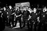 NEW YORK, NY — SEPTEMBER 24, 2020:  NYPD officers stand in a line during a protest against a Kentucky Grand Jury decision to not directly indict the officers involved in the shooting of Breonna Taylor, a 26 year-old EMT who was killed in her Louisville home by police on March 13th of this year, on September 24, 2020 in New York City.  Former police detective Brett Hankison faces three felony charges of wanton endangerment.  Photograph by Michael Nagle