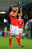 Joe Ledley of Wales applauds home supporters with his boots during the FIFA World Cup Qualifier Group D match between Wales and Republic of Ireland at The Cardiff City Stadium, Wales, UK. Monday 09 October 2017