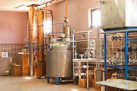 Distillation machine still with steel and copper boiler and column to make grape juice spirit. Kantina Miqesia or Medaur winery, Koplik. Albania, Balkan, Europe.