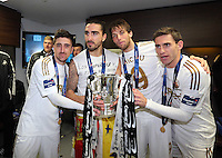 Pictured L-R:Spaniard Swansea players Pablo Hernandez, Chico Flores, Michu and Angel Rangel celebrating with the cup in the changing rooms after the game.  Sunday 24 February 2013<br /> Re: Capital One Cup football final, Swansea v Bradford at the Wembley Stadium in London.