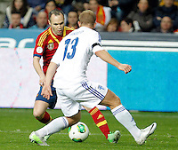 Spain's Andres Iniesta (l) and Finland's Arkivuo during international match of the qualifiers for the FIFA World Cup Brazil 2014.March 22,2013.(ALTERPHOTOS/Victor Blanco)