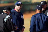 Shippensburg Red Raiders head coach Matt Jones #27 meets at home plate with the umpires and Catawba Indians manager Jim Gantt #8 prior to the start of their game at Newman Park on February 12, 2011 in Salisbury, North Carolina.  Photo by Brian Westerholt / Four Seam Images