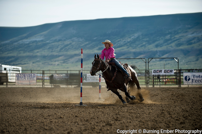 Anna Zowada in the Pole Bending Event Thursday 2nd round event at the Wyoming State High School Finals Rodeo in Rock Springs Wyoming.  Photo by Josh Homer/Burning Ember Photography.  Photo credit must be given on all uses.