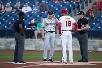 Delmarva Shorebirds manager Dave Anderson (7) meets with Fredericksburg Nationals manager Mario Lisson (18) and umpires Tre Jester (left) and Matt Blackborow (right) prior to their game at Fredericksburg Nationals Ballpark on July 28, 2021 in Fredericksburg, Virginia. (Brian Westerholt/Four Seam Images)