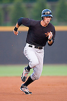 Billy Rowell #11 of the Frederick Keys hustles towards third base versus the Winston-Salem Dash at Wake Forest Baseball Stadium August 6, 2009 in Winston-Salem, North Carolina. (Photo by Brian Westerholt / Four Seam Images)