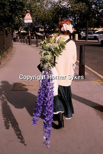 Chelsea Flower Show London. The last day, visitors at the end of the show are able to buy the specimens that have been in the show and are taking them home. These are delphiniums  didn't make the journey home safely. 1985. 1980s UK