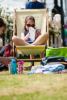 Tuesday 31 May 2016. Hay on Wye, UK<br /> Pictured: A young girl relaxes in the sun at the Hay Festival <br /> Re: The 2016 Hay festival take place at Hay on Wye, Powys, Wales