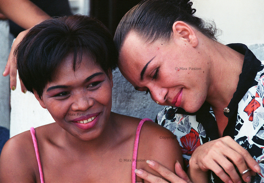 Gay prostitutes. The one on the right is an Amerasian, son of a United States serviceman as US Air Force used to maintain a base in Angeles city, Pampanga, Philippines where this picture was taken. October, 2002