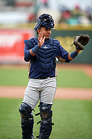 Burlington Bees catcher Mario Sanjur (26) asks for time during a game against the Great Lakes Loons on May 4, 2017 at Dow Diamond in Midland, Michigan.  Great Lakes defeated Burlington 2-1.  (Mike Janes/Four Seam Images)