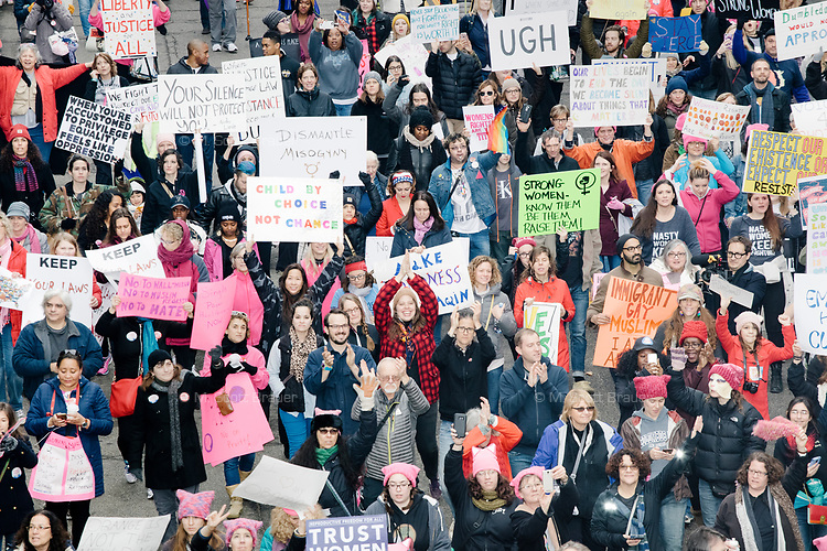 People gather in the National Mall area of Washington, DC, for the Women's March on Washington protest and demonstration in opposition to newly inaugurated President Donald Trump on Jan. 21, 2017.