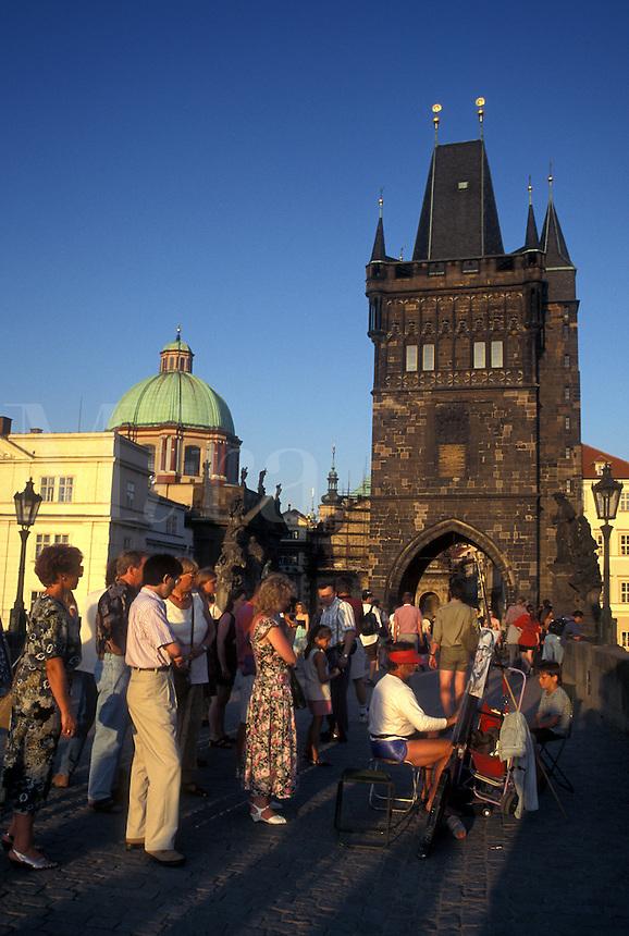 Prague, Charles Bridge, Czech Republic, Praha, Central Bohemia, Street artist on Charles Bridge.