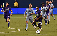 KANSAS CITY, KS - SEPTEMBER 23: #7 Johnny Russell of Sporting Kansas City tries to cover #17 Nani of Orlando City SC as he begins a drive upfield during a game between Orlando City SC and Sporting Kansas City at Children's Mercy Park on September 23, 2020 in Kansas City, Kansas.