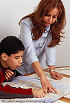 boy 12 years old with mother, looking at subway map, planning trip vertical