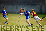 Annascaul'sJames Scanlon been tackled by Maurice O'Connor of Duagh in the Junior Club Football Championship Qtr Final.