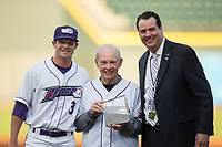 "Former Wake Forest Demon Deacons men's basketball head coach Dave Odom (center) is flanked by Winston-Salem Dash outfielder Jake Fincher (3) and Winston-Salem Dash President Geoff Lassiter after receiving the ""Service Through Sports Award"" prior to the game against the Buies Creek Astros at BB&T Ballpark on April 13, 2017 in Winston-Salem, North Carolina.  The Dash defeated the Astros 7-1.  (Brian Westerholt/Four Seam Images)"