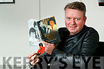 """Mark Leen pictured with his book on Billy Curtin """"Curtin Call"""""""