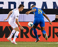 PHILADELPHIA, PA - JUNE 30: Aaron Long #23 challenges Jafar Arias #19 during a game between Curaçao and USMNT at Lincoln Financial Field on June 30, 2019 in Philadelphia, Pennsylvania.
