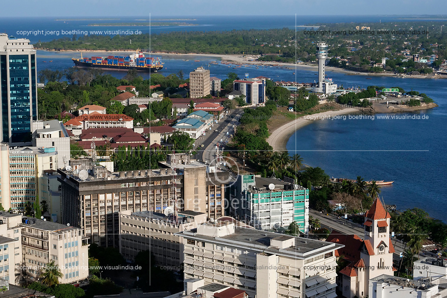 TANZANIA Daressalaam, bay and seaport, PIL container ship sailing to indian ocean, in front protestant Azania Front cathedral, built during german colonial time, Kigamboni Ferry Terminal