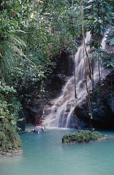 Tourists taking boat tour into falls, Somerset Falls, Port Antonio, Jamaica, January 2005