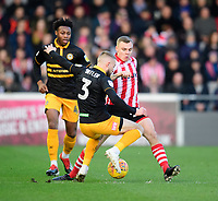 Lincoln City's Harry Anderson vies for possession with Newport County's Dan Butler<br /> <br /> Photographer Chris Vaughan/CameraSport<br /> <br /> The EFL Sky Bet League Two - Lincoln City v Newport County - Saturday 22nd December 201 - Sincil Bank - Lincoln<br /> <br /> World Copyright © 2018 CameraSport. All rights reserved. 43 Linden Ave. Countesthorpe. Leicester. England. LE8 5PG - Tel: +44 (0) 116 277 4147 - admin@camerasport.com - www.camerasport.com