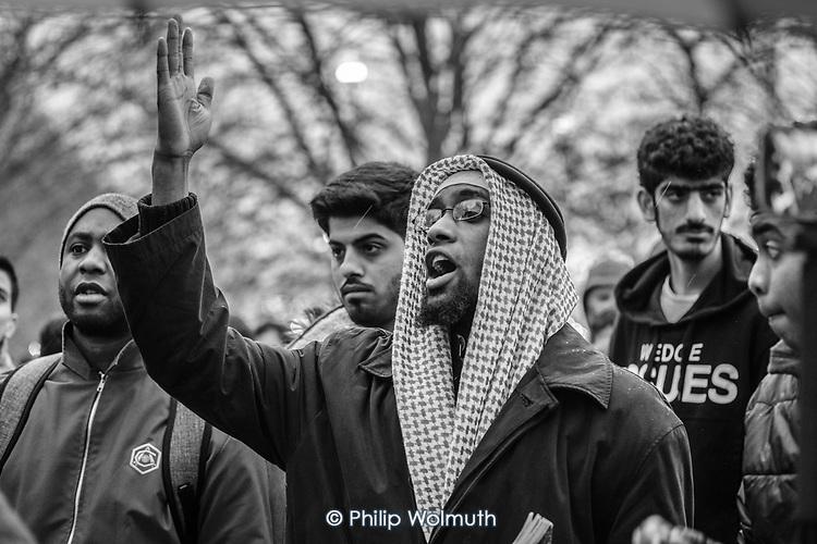 A Muslim  heckles a Christian preacher at Speakers' Corner, Hyde Park, London; 2017.