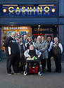 "20/11/15<br /> <br /> L/R: Alan Kent, Diane Kent, Simon Gudgeon, Lorna Cord, Helen Stockdale, Arron Kent, , Wanda Kidd, Linda Lindsay, Gemma Wylie and Janet Neal.<br /> <br /> Thanks to the joint fundraising efforts of customers and staff at Cashino adult gaming centre on Station Street Burton-On-Trent, Arron Kent, a seventeen year old teenager from Swadlincote has received a new, customised powered wheelchair to help boost his mobility. <br /> <br /> Arron, who lives with his mum, Diane, dad Alan and sister Tabitha, suffers from Osteogenesis Imperfecta – a severe brittle bone disease which has seriously affected Arron's ability to walk. His condition means his bones break easily, often from mild trauma or with no apparent cause.  <br /> <br /> Arron currently has a basic powered wheelchair  but as his condition progresses the chair is becoming inadequate to meet Arron's growing needs. <br /> <br /> Arron's mum Diane said: ""We are very grateful to Cashino and CHIPS charity for providing Arron with a new state of art powered wheelchair. As he develops into adulthood, it is important that he maintains his independence, this powered wheelchair with features including adjustable height, tilt in space and excellent manoeuvrability will literally revolutionise Arron's life. <br /> <br /> Diane continues ""Arron is developing his hobby of showing rabbits and the rise and fall feature of his new wheelchair means he can now reach the judging tables without needing the assistance of another person.""<br /> <br /> Cashino, which operates 155 adult gaming centres across the country, is one of the main fundraisers for CHIPS, a charity set up on behalf of the casino and gaming industry, which aims to provide specialised wheelchairs for children and young people with severe mobility problems.<br /> <br /> Janet Neal, manager of Cashino Burton-On-Trent, presented Arron with his new wheelchair last Friday, 20th November 2015.<br /> <br /> Speaking after the presentation, Janet Neal said: ""Arron is a lovely young man and is so deserving of this wheelchair. It makes all the fund"