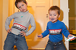 I wanted to take a portrait of both my sons, ages five and two, after they stuck bumper stickers from the auto show on their bellies, but was unable to get them to stand still.