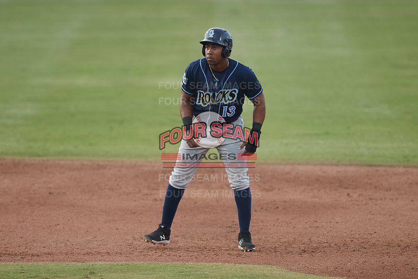 Omar Meregildo (13) of the Wilmington Blue Rocks takes his lead off of second base against the Greensboro Grasshoppers at First National Bank Field on May 25, 2021 in Greensboro, North Carolina. (Brian Westerholt/Four Seam Images)