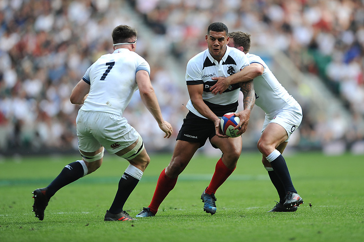 Josh Matavesi (Newcastle Falcons & Fiji) of Barbarians is tackled by Piers Francis and Tom Curry of England during the Quilter Cup match between England and Barbarians at Twickenham Stadium on Sunday 27th May 2018 (Photo by Rob Munro/Stewart Communications)