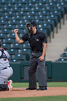 Home plate umpire Shin Koishizawa calls a strike during an Arizona League game between the AZL Indians 2 and the AZL Angels at Tempe Diablo Stadium on June 30, 2018 in Tempe, Arizona. The AZL Indians 2 defeated the AZL Angels by a score of 13-8. (Zachary Lucy/Four Seam Images)