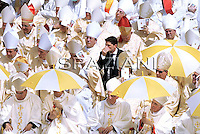 Pope Benedict XVI waves as he arrives in Saint Peter's Square at the Vatican before a mass on June 11, 2010 with some 15,000 priests marking the end of the Roman Catholic Church's Year for Priests.