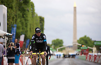 Chris Froome (GBR/SKY) returning from the teambus on his way to the podium ceremony to get officially awarded as the 2015 Tour winner<br /> <br /> stage 21: Sèvres - Champs Elysées (109km)<br /> 2015 Tour de France