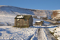 Snow on free range poultry buildings at Higher Fence Wood Farm, Whitewell, Lancashire looking towards Whitmore Fell.