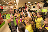 ASDA Community Colleague Sharon Allsop pictured with girls from 1st Langley Mill Brownies aiming to earn their Cookery badge