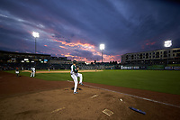 Fort Wayne TinCaps relief pitcher Dylan Coleman (8) warms-up in the bullpen as the sun sets behind Parkview Field during the Midwest League game against the Bowling Green Hot Rods on August 20, 2019 in Fort Wayne, Indiana. The Hot Rods defeated the TinCaps 6-5. (Brian Westerholt/Four Seam Images)