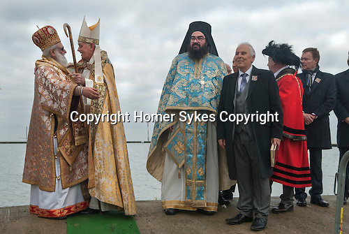 Greek community Uk. Margate Kent. Greek Orthodox Church of the Archangel Michael  L - R The Greek Archbishop Gregorios of Thyateira and Great Britain,  and the Bishop of Dover Trevor Willmott, The Very Revd. Archimandrite Vissarion Kokliotis, ( in blue robes) Mr Michael Papadopoullos, president of Margate's Greek Community, the Mayor of Margate and other officials at The Blessing of the Sea ceremony to celebrate  Epiphany 6th January 2017.