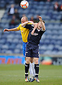 ROVERS' JOHN BAIRD GETS AN ELBOW IN THE SIDE OF THE HEAD FROM ACCIES ALEX NEIL