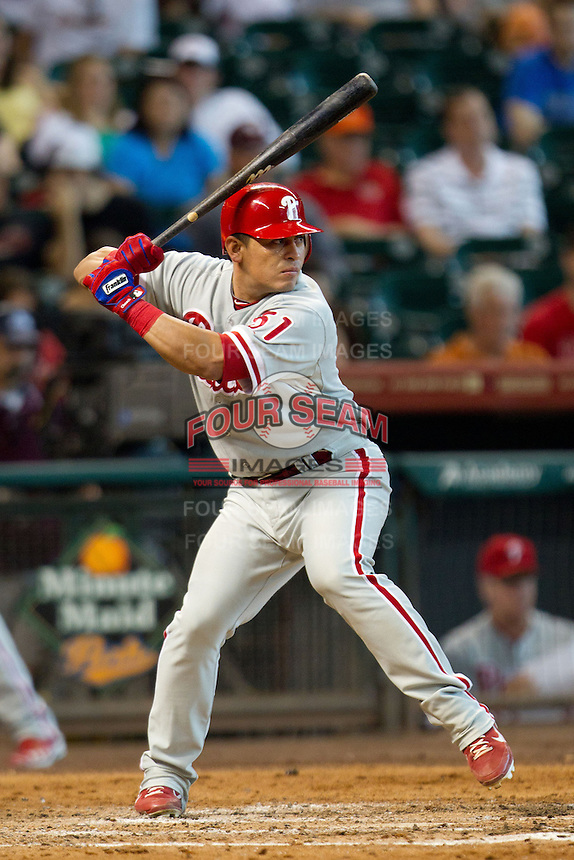 Philadelphia Phillies catcher Carlos Ruiz #51 at bat during the Major League baseball game against the Houston Astros on September 16th, 2012 at Minute Maid Park in Houston, Texas. The Astros defeated the Phillies 7-6. (Andrew Woolley/Four Seam Images).