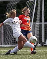 Boston College forward/midfielder Rachel Davitt (24) breaks up University of Virginia midfielder Morgan Brian (6) dribble. Boston College defeated University of Virginia, 2-0, at the Newton Soccer Field, on September 18, 2011.