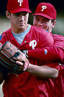 Scott Rolen and Mike Leiberthal of the Philadelphia Phillies participates in a Major League Baseball game at Dodger Stadium during the 1998 season in Los Angeles, California. (Larry Goren/Four Seam Images)