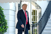 United States President Donald J. Trump walks out of the White House in Washington D.C., U.S., as he departs for Yuma, Arizona on Tuesday, June 23, 2020.  Trump stated that he authorized the Federal government to arrest any demonstrator caught vandalizing U.S. monuments, with a punishment of up to 10 years in prison.  Credit: Stefani Reynolds / CNP/AdMedia