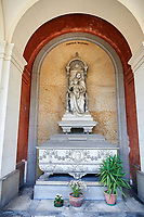 Pictures of the stone sculpture of a Madonna and child in Realistic style. The Baldulno Family Tomb sculpted by G Monteverde 1889. Section D no 28, the monumental tombs of the Staglieno Monumental Cemetery, Genoa, Italy